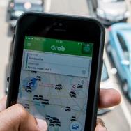 Perang Tarif Uber Versus Grab di ASEAN, Siapa Juara?