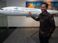 Garuda Indonesia dan Grab Kerja Sama Tingkatkan Layanan