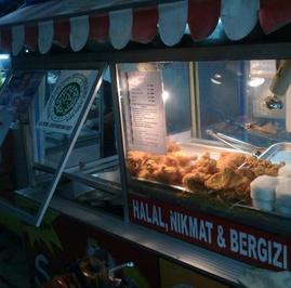 Jurus KFC Mengepung Bisnis Ayam Goreng Kaki Lima